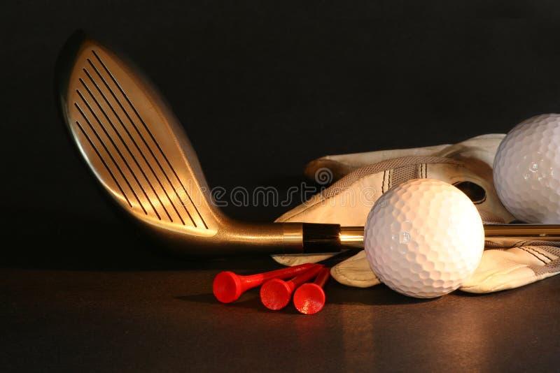 Golf essentials. On black background royalty free stock photo