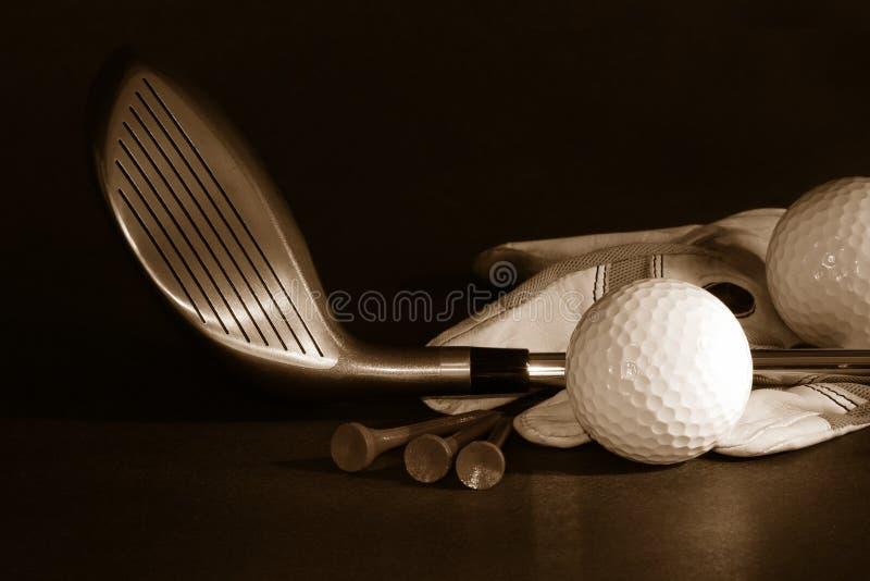 Golf essentials/ B/W. Golf essentials on black background royalty free stock photography