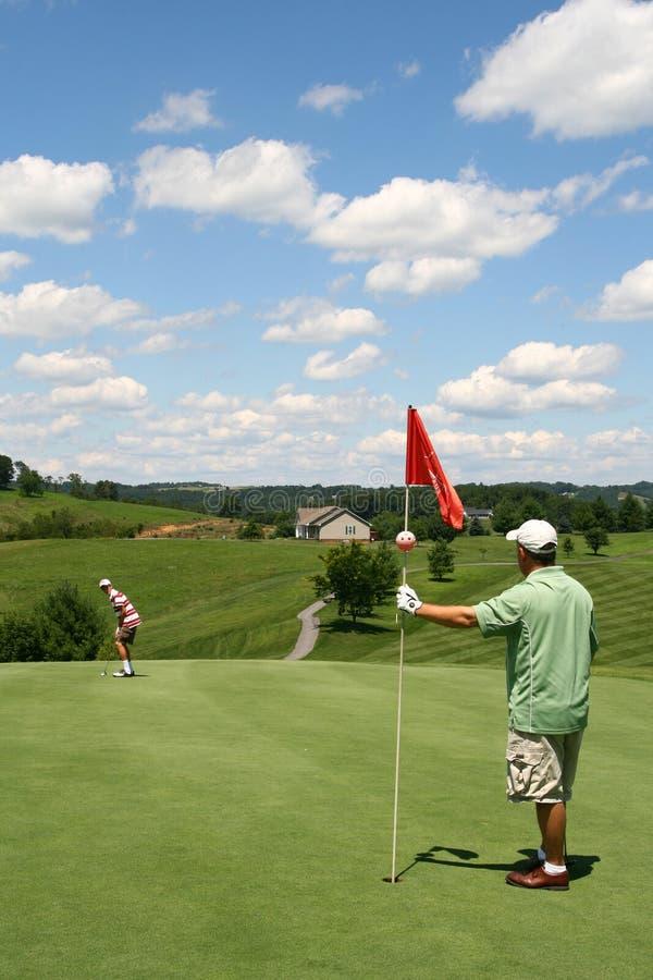 golf för bollfaderflagga som sätter att ansa för son royaltyfria foton