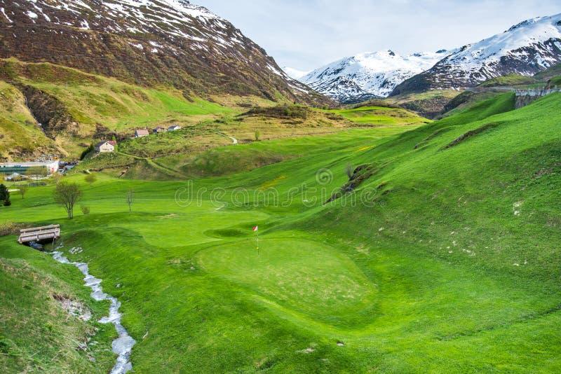 Golf field in the alpen village royalty free stock photo