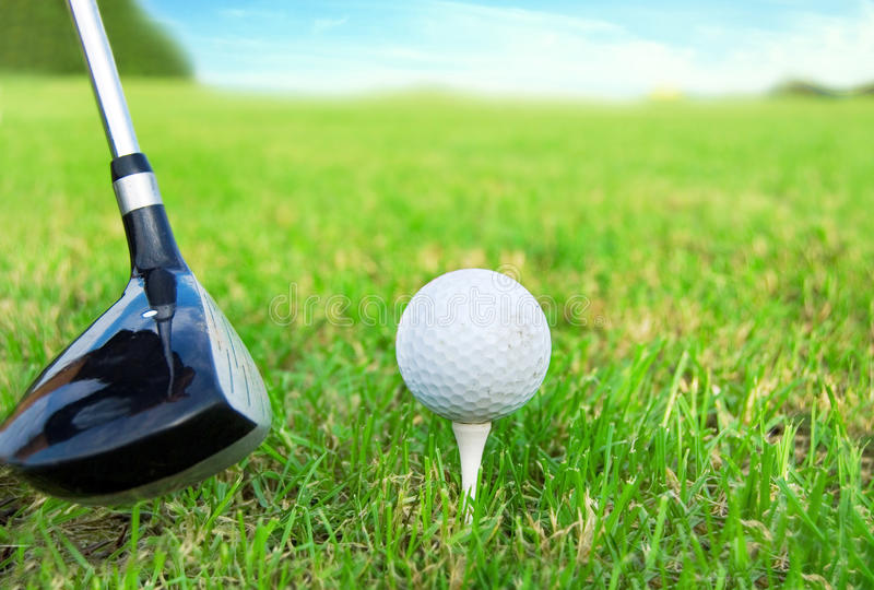 Golf game. Hitting the golf ball with club royalty free stock photos