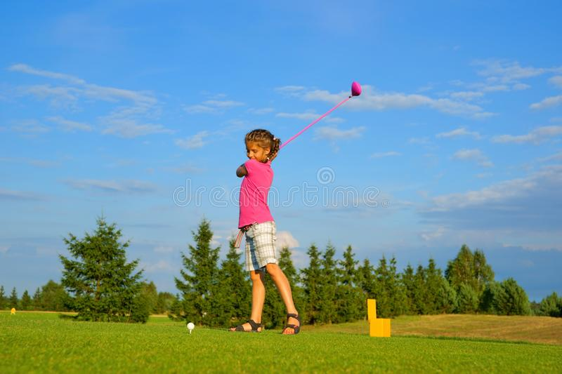 Golf, girl golfer is going to punch the ball stock photos