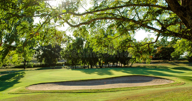 Golf green and bunker royalty free stock photo