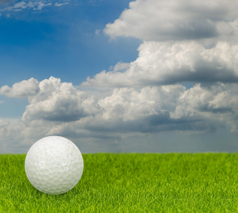 Golf on a green grass with sky background. A Golf on a green grass with sky background stock photo