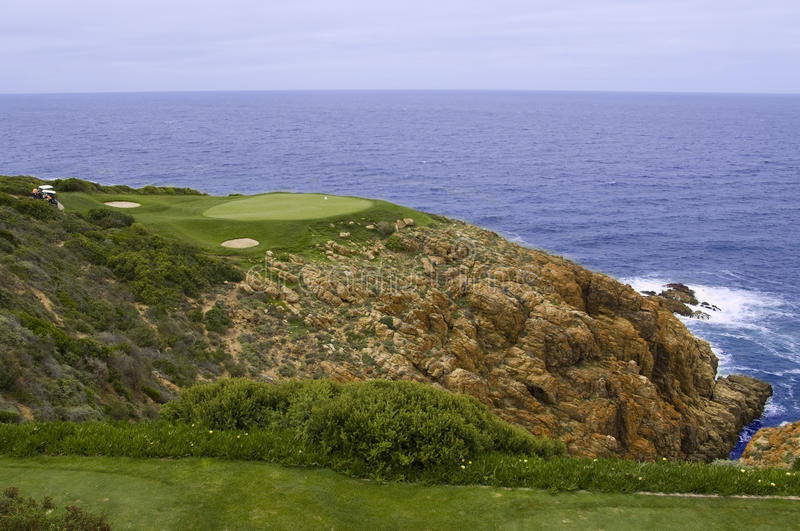 Golf green and sea. Perfect golf green hole at the sea stock images