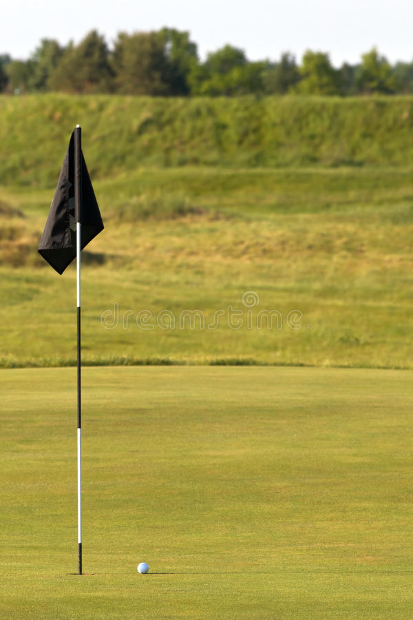 Free Golf Green With Flag Pole And Ball In Foreground Stock Image - 19132021