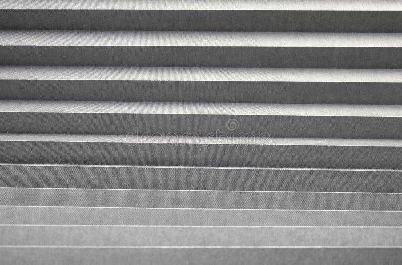 Golf grijs gordijn Geweven grijze achtergrond stock fotografie