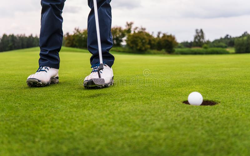 Golf hit on green stock photography