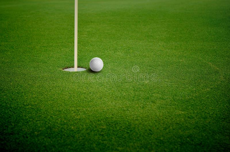 The golf hole on background royalty free stock photo