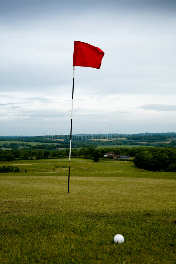 Golf hole and ball stock photography