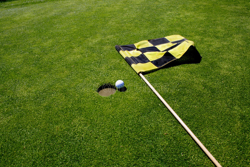 Golf hole and flag. royalty free stock images
