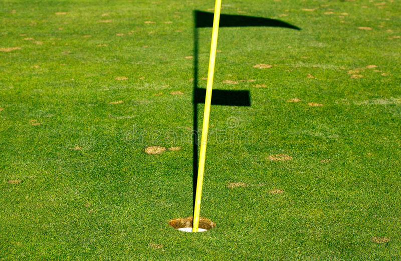 Download Golf Hole On A Green With Hole Stock And Shadow Of The Flag Stock Photo - Image: 30335442