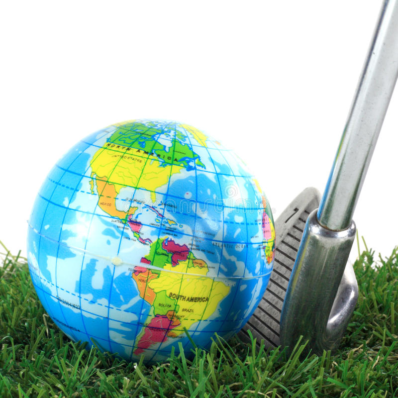 Golf iron and earth ball stock photography