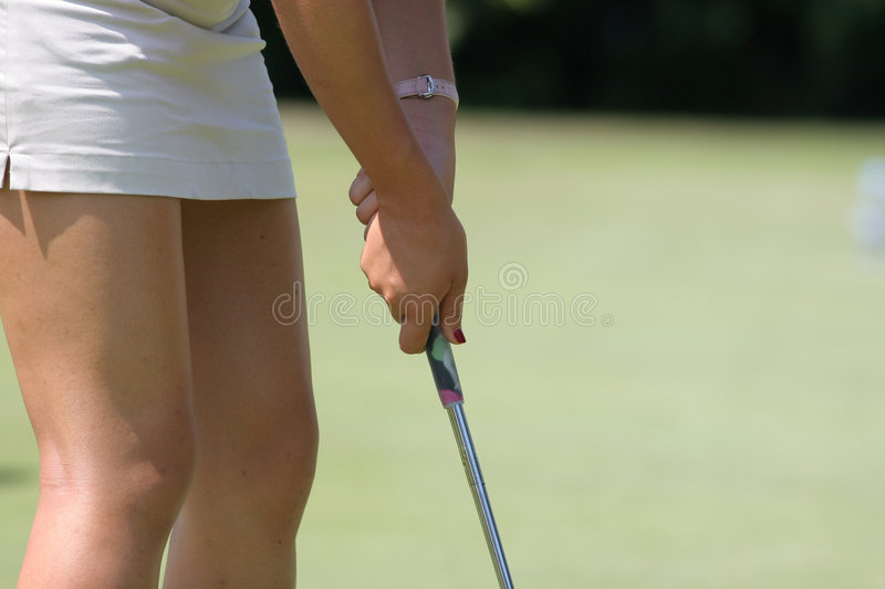 Golf lady at putting stock photography
