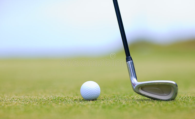 Golf Macro. Golf stick and ball on green grass stock image