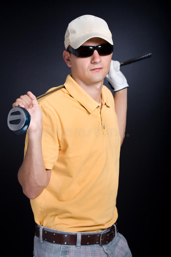 Golf man. The male golf player with a driver royalty free stock images