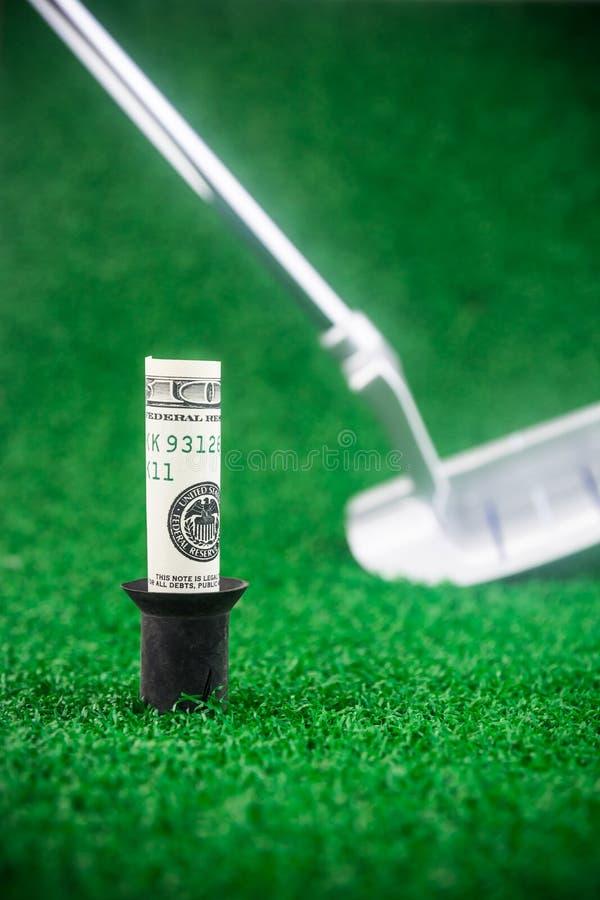 Golf mit Geld stockbild