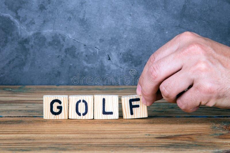 Golf - ord fr?n tr?bokst?ver royaltyfria foton