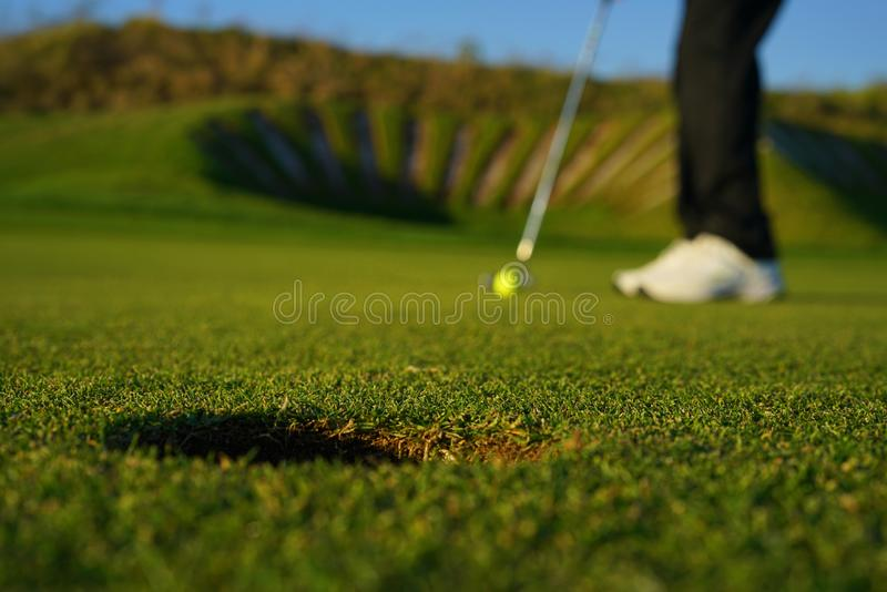The golf player and the  golf ball stock images