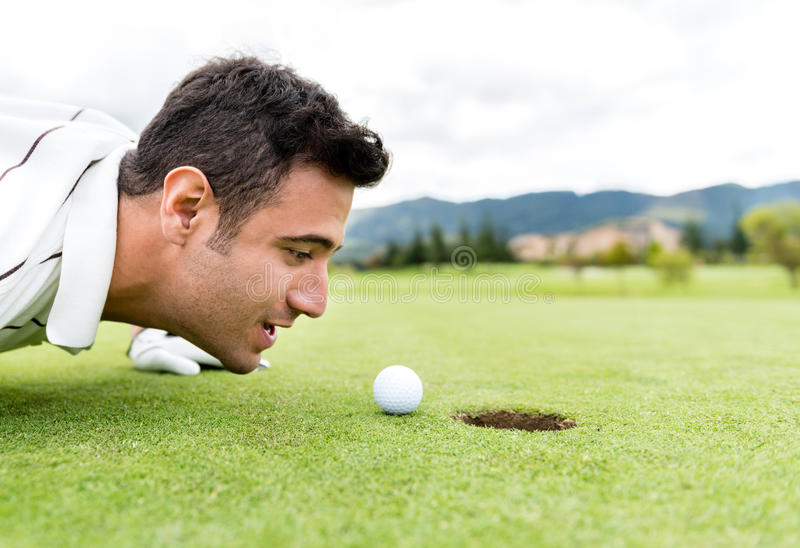 Download Golf Player Blowing The Ball Stock Photo - Image: 33915024