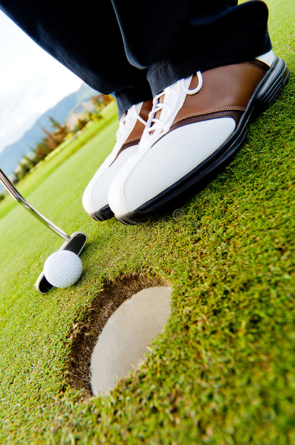Download Golf Player Hitting The Ball Stock Image - Image: 23133601