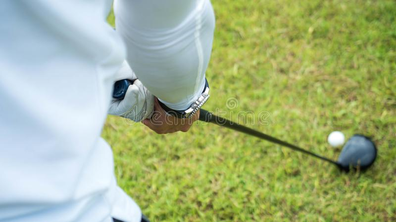 Golf player hitting beautiful shot with club on course in the park stock images