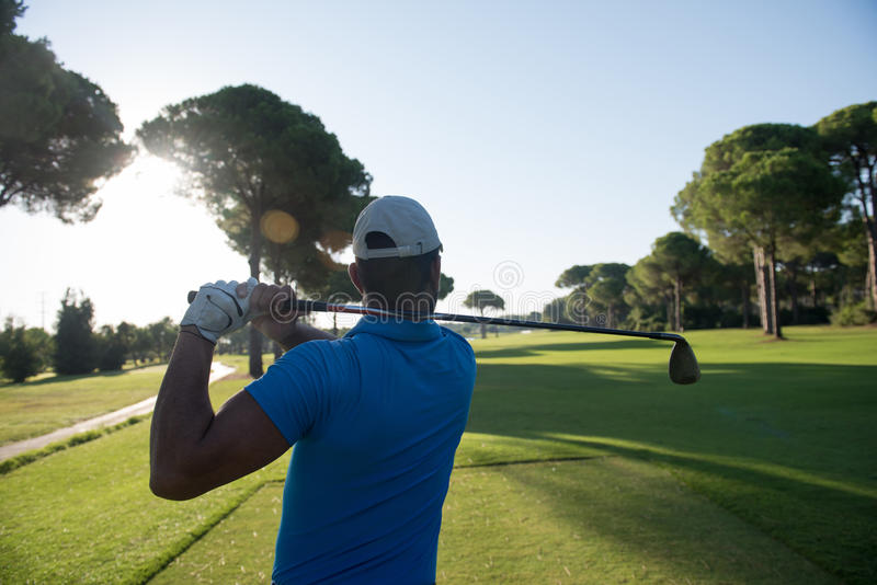 Golf player hitting shot stock photo