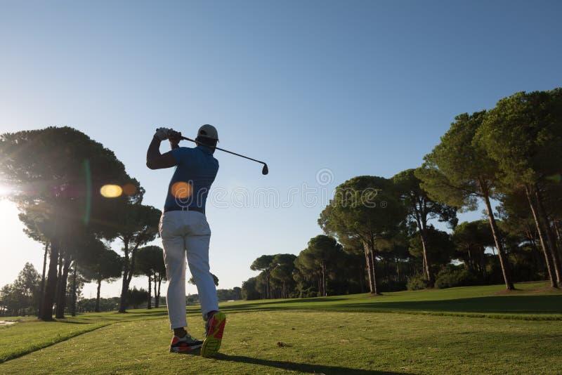 Golf player hitting shot stock photos