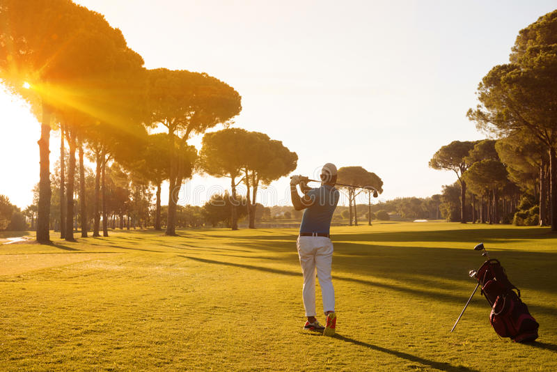 Golf player hitting shot with club stock image