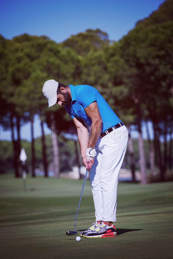 Golf player hitting shot at sunny day stock photography