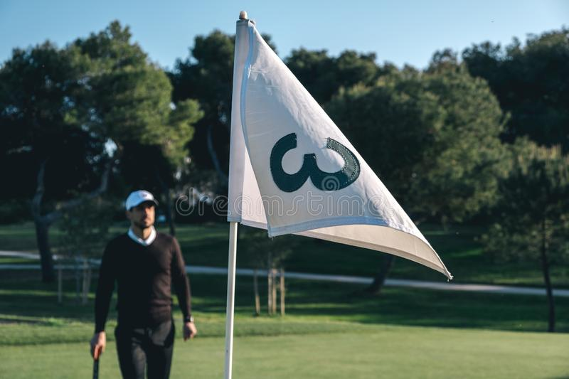 A golf player observes a golf course stock photo