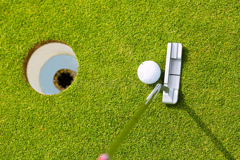 Download Golf Player Putting Ball In Hole Stock Image - Image: 29398053