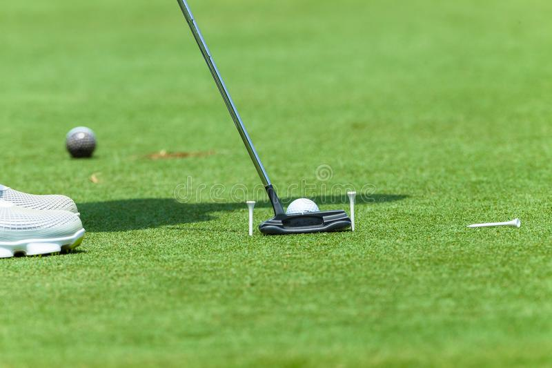 Golfer Putting Ball Shoes Pegs stock photos