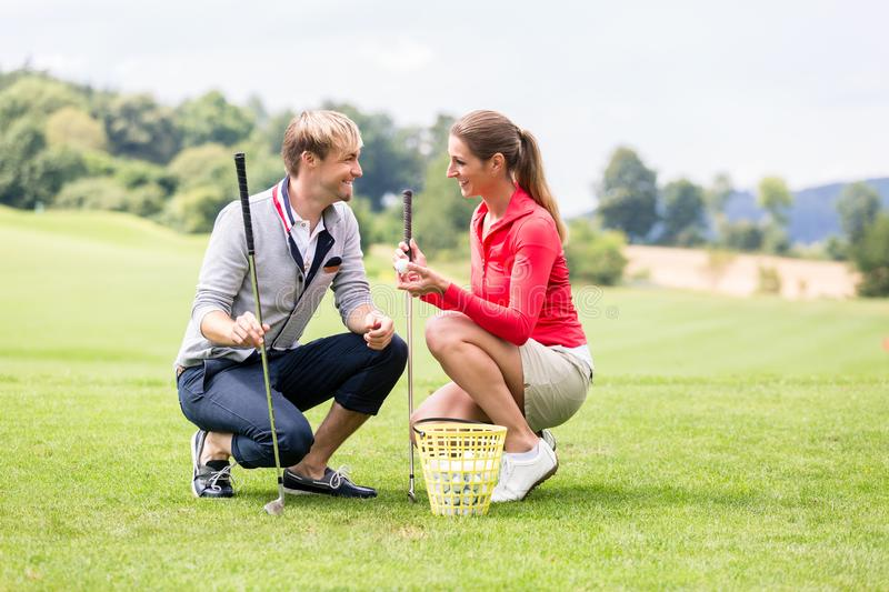 Golf players discussing before playing stock image