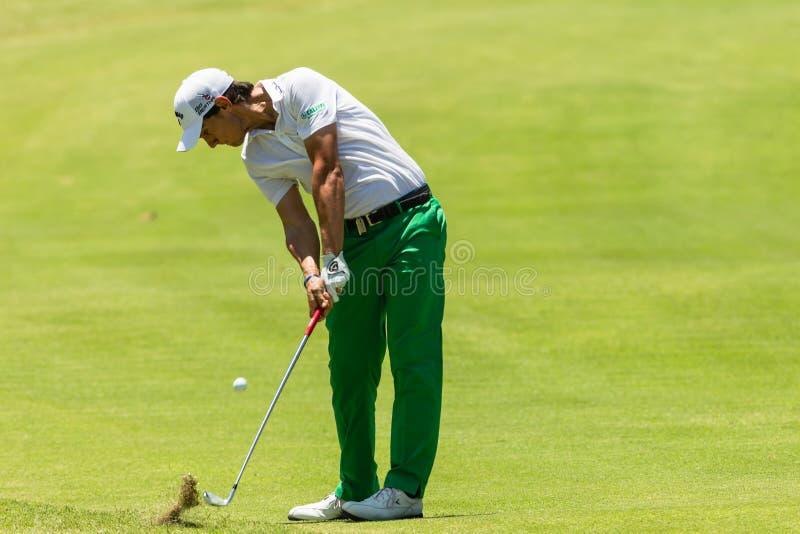 Golf Professional Matteo Manaserro Swinging. Professional Matteo Manassero strikes golf ball at the European PGA Tournament Volvo Golf Champions Tournament royalty free stock image