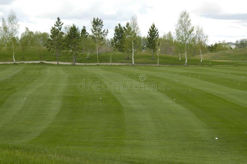 Golf sätter in för borrar fotografering för bildbyråer