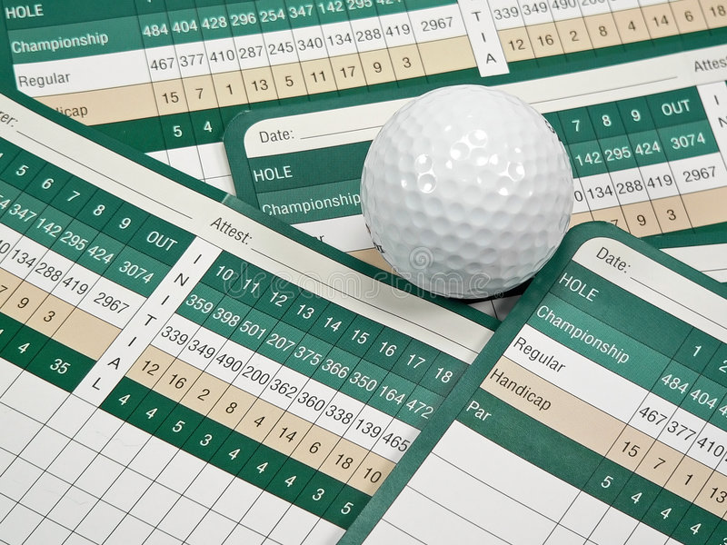 Golf Scorecards. A golfer's scorecard, pencil, tees, ball, and course book stock photos