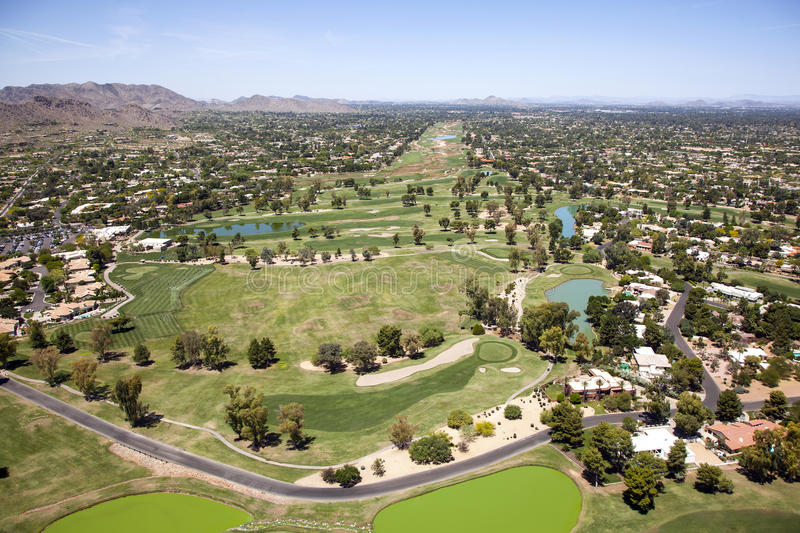 Golf in Scottsdale. Golf course carved out between custom homes in plush Scottsdale, Arizona royalty free stock photography
