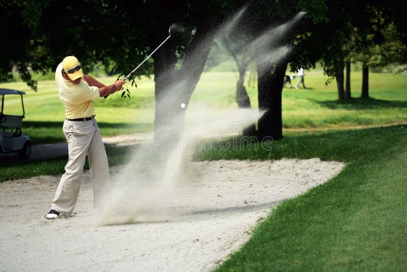 Golf Send Technic. A golf sand shot royalty free stock photo