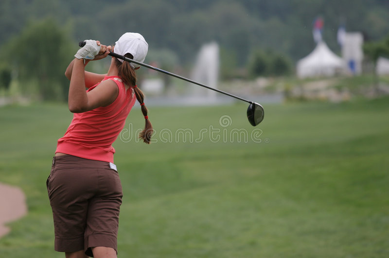 Golf swing in losone. Lady golf swing in losone, switzerland royalty free stock photography
