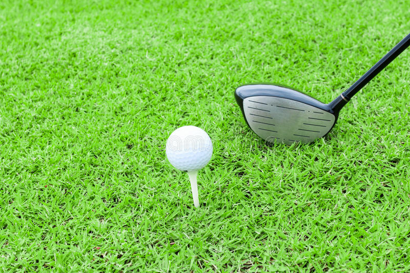 golf tee ball club driver in green grass course preparing to shot stock photography