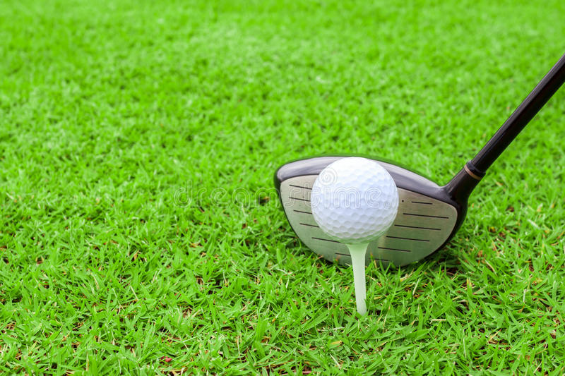 golf tee ball club driver in green grass course preparing to shot stock photo