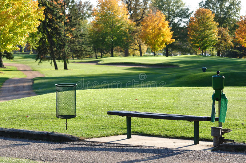 Golf Tee Box and Bench. In Autumn royalty free stock image