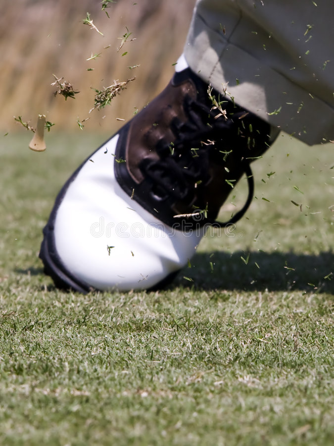 Golf tee flying after impact stock photo
