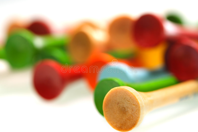 Golf tees. A shot of golf tees on white royalty free stock photography