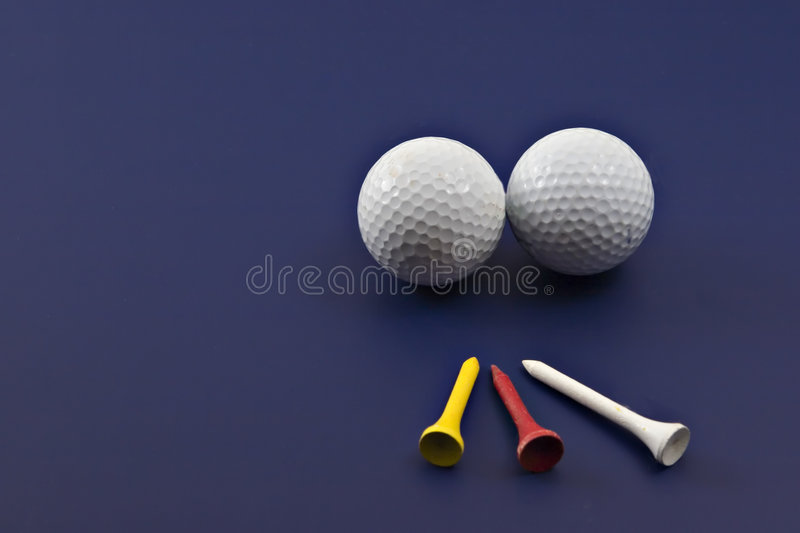 Golf and tees on blue