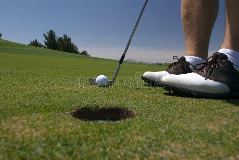 Golf about to putt royalty free stock photography
