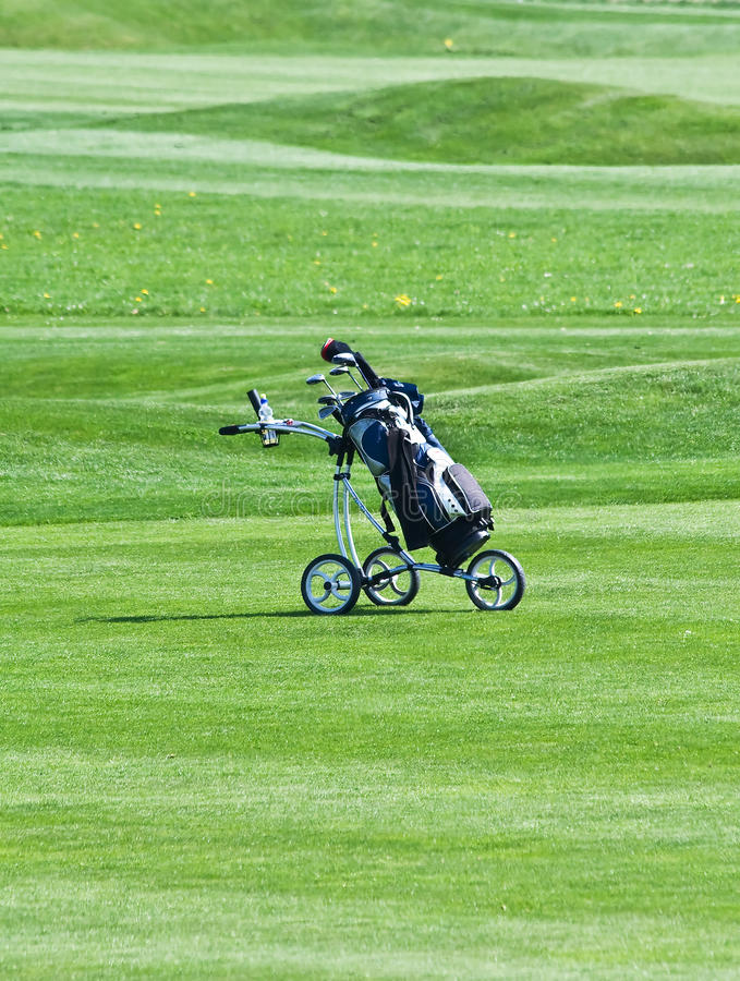 Golf trolley. On the green grass royalty free stock photos