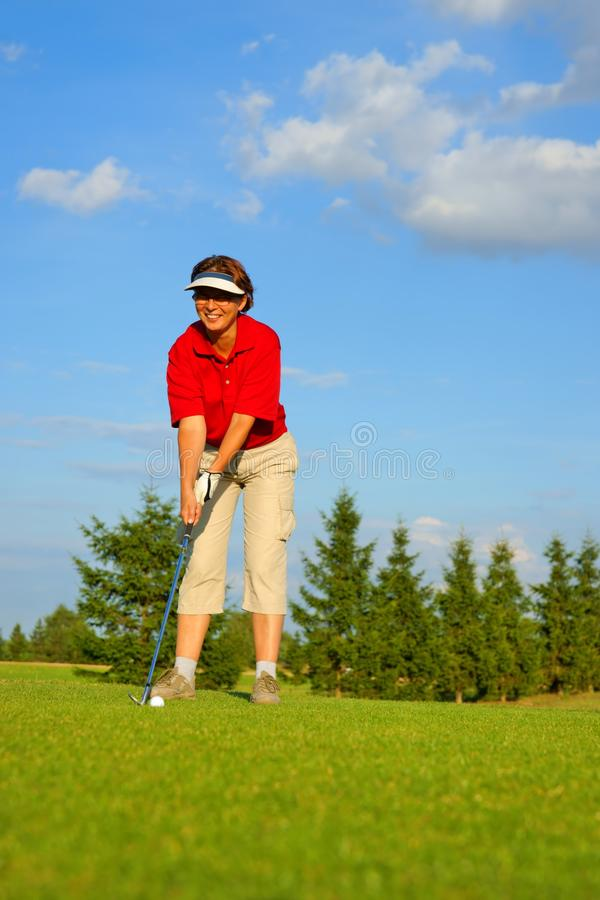 Golf, woman golfer is going to punch the ball stock images