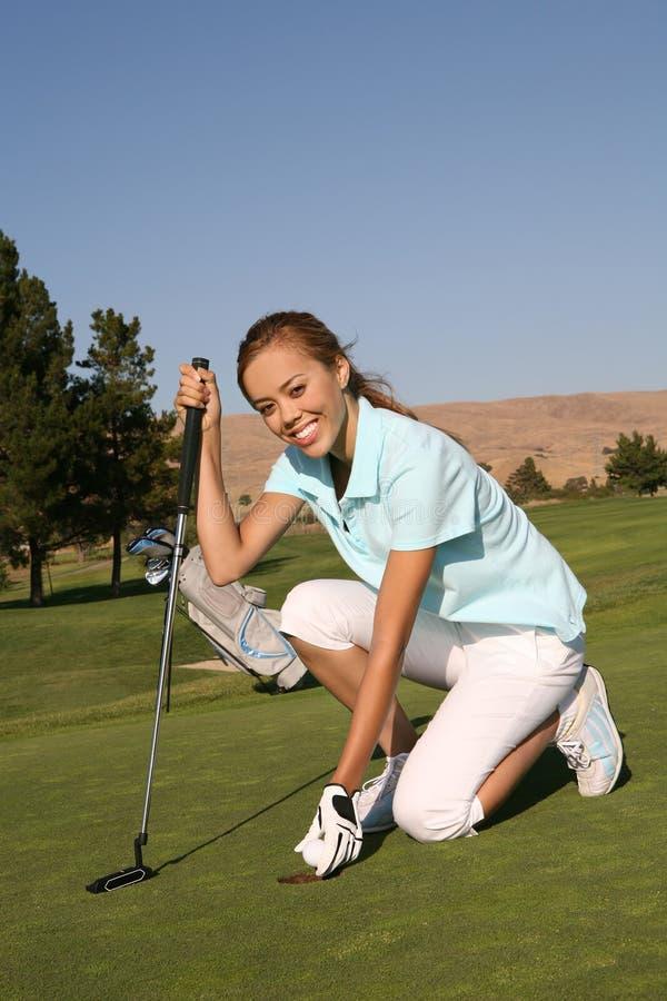golfarekvinna arkivfoton